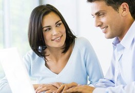 picture of woman and man looking at laptop screen